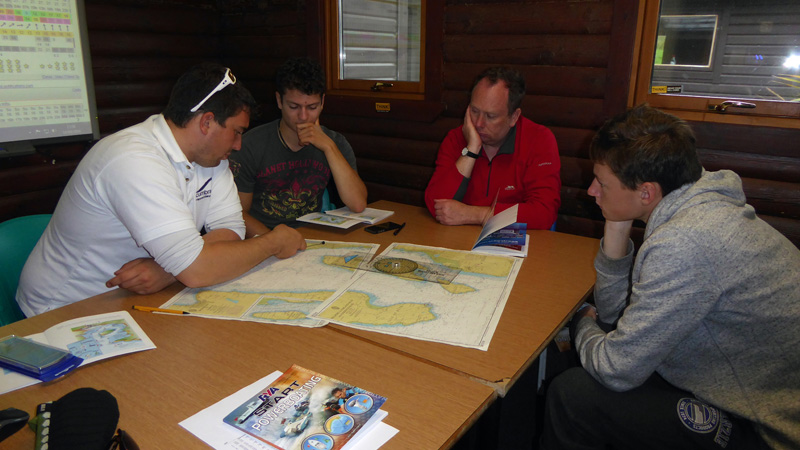 Tom discusses chart work with Zac, Craig and Graham