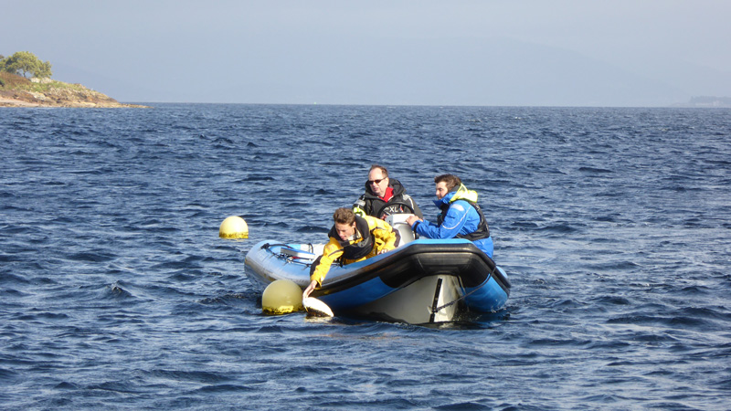 Graham picks up a mooring buoy